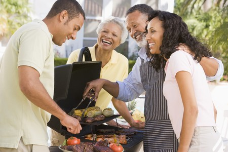 Family Enjoying A Barbeque Stock Photo - 4506975