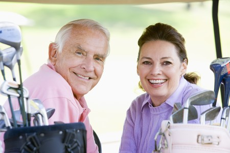 Couple Enjoying A Game Of Golf Stock Photo - 4506860