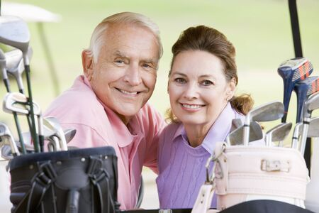 Couple Enjoying A Game Of Golf Stock Photo - 4506939