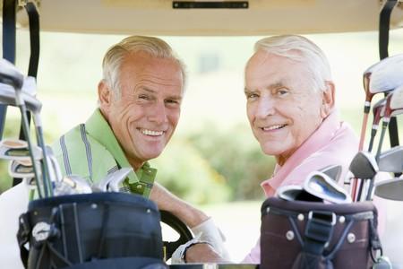 Male Friends Enjoying A Game Of Golf photo