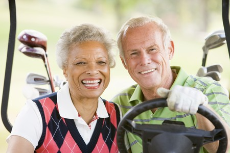 golf cart: Couple Enjoying A Game Of Golf