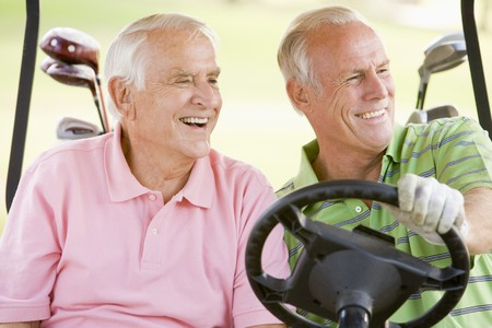 Male Friends Enjoying A Game Of Golf Stock Photo - 4507125