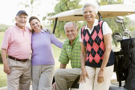 Portrait Of Four Friends Enjoying A Game Golf Stock Photo - 4507042