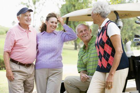 Portrait Of Four Friends Enjoying A Game Golf photo