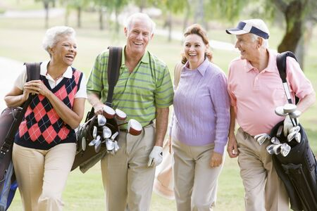 woman golf: Portrait Of Four Friends Enjoying A Game Golf