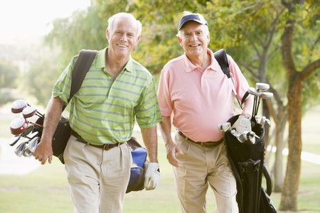 golf club: Male Friends Enjoying A Game Of Golf Stock Photo