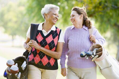 senior friends: Female Friends Enjoying A Game Of Golf Stock Photo