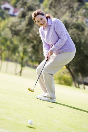 Woman Playing A Game Of Golf photo