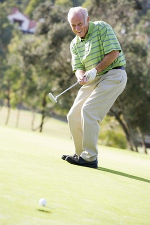one senior: Man Playing A Game Of Golf