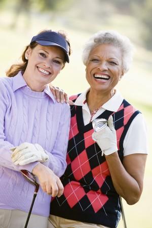 Portrait Of Two Female Golfers photo
