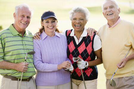 Portrait Of Four Friends Enjoying A Game Golf Stock Photo - 4507165