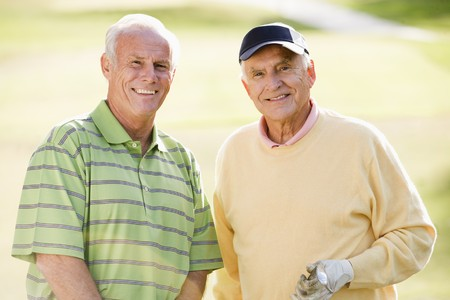 healthy seniors: Male Friends Enjoying A Game Of Golf Stock Photo