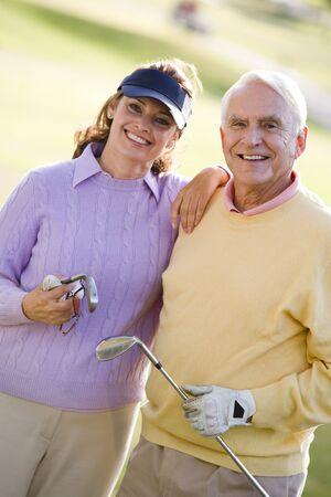 Couple Enjoying A Game Of Golf photo