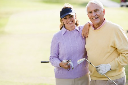 woman golf: Couple Enjoying A Game Of Golf