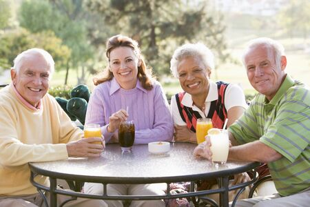 Friends Enjoying A Beverage By A Golf Course Stock Photo - 4507108