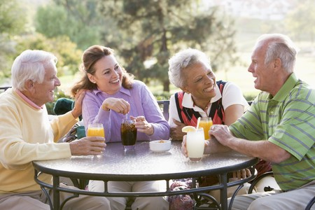 Friends Enjoying A Beverage By A Golf Course Stock Photo - 4507121