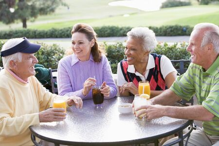 Friends Enjoying A Beverage By A Golf Course Stock Photo - 4507119