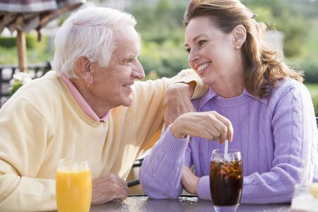 Couple Enjoying A Beverage By A Golf Course Stock Photo - 4507110