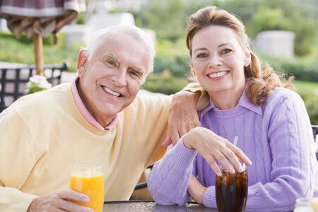 Couple Enjoying A Beverage By A Golf Course Stock Photo - 4507044
