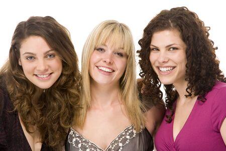 plus size woman: Portrait Of Three Women Smiling Stock Photo