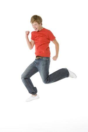 air jump: Teenage Boy Jumping In The Air