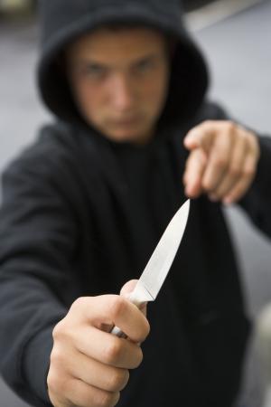 youth crime: Teenage Boy Brandishing Knife
