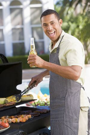 Man Barbequing In A Garden photo