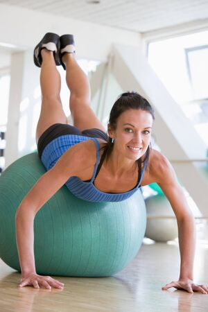Woman Doing Push Ups On Swiss Ball At Gym Stock Photo - 4507289