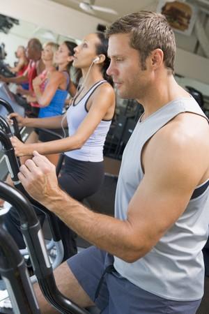 Man Running On Treadmill At Gym photo