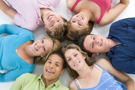 Teenagers Lying Down Head To Head photo