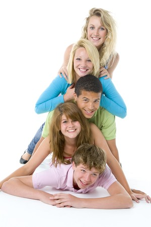 16 year old girls: Teenagers On Top Of One Another Stock Photo