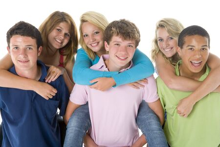 Teenage Girls Piggy Back On Boys photo