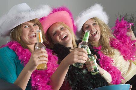 house party: Dressed Up Teenage Girls Enjoying Drinks