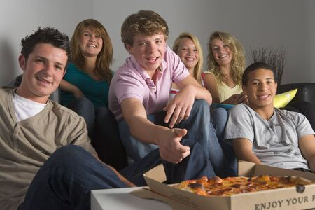 Teenagers Having Fun And Eating Pizza Stock Photo - 4507512
