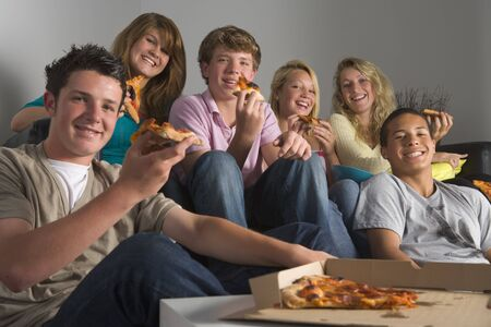 Teenagers Having Fun And Eating Pizza photo