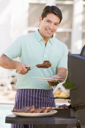 Man Barbequing In A Garden Stock Photo - 4498942