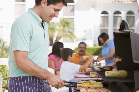Family Enjoying A Barbeque Stock Photo - 4499054