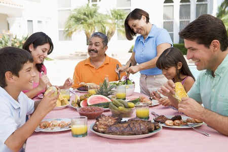 Family Enjoying A Barbeque Stock Photo - 4499132