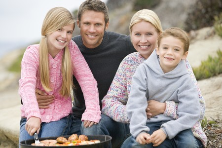 Family Enjoying A Barbeque Stock Photo - 4499860