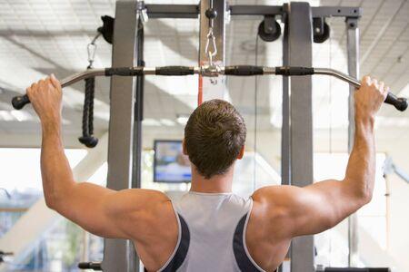 Man Weight Training At Gym photo