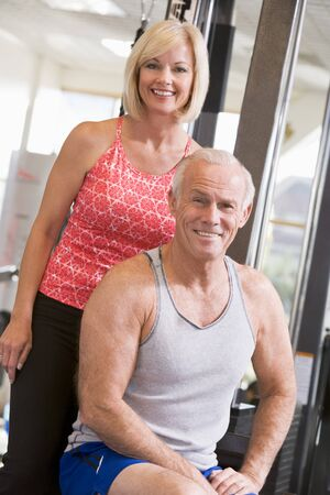 Man And Woman At Gym Together photo