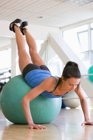 Woman Doing Push Ups On Swiss Ball At Gym Stock Photo - 4498827