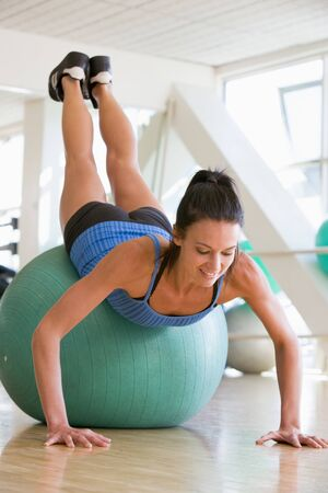 Woman Doing Push Ups On Swiss Ball At Gym Stock Photo - 4498919
