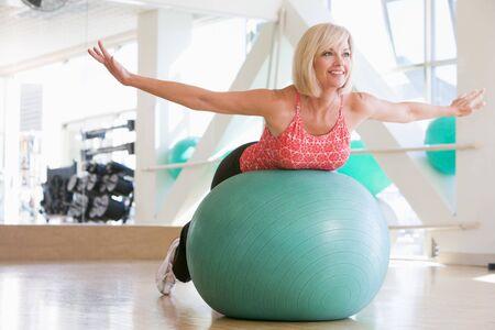 Woman Balancing On Swiss Ball photo