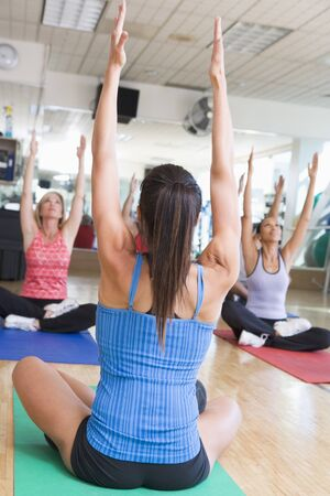 Instructor Taking Yoga Class At Gym photo