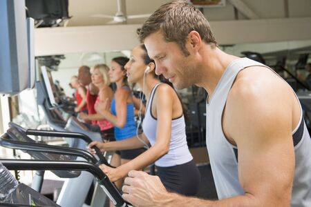 middle aged men: Man Running On Treadmill At Gym Stock Photo
