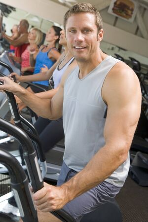 Man Running On Treadmill At Gym photo