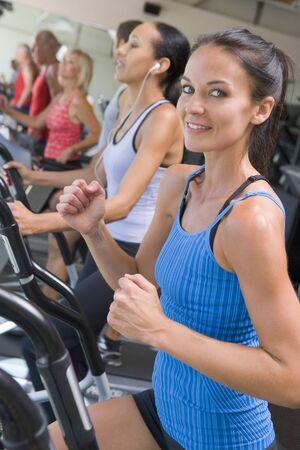 Woman Running On Treadmill At Gym Stock Photo - 4499417