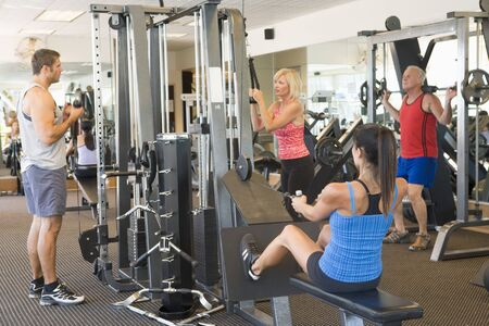Group Of People Weight Training At Gym Stock Photo - 4499872