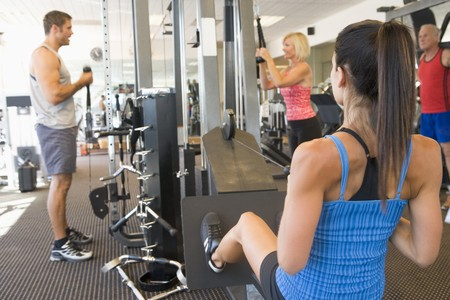 back training: Group Of People Weight Training At Gym